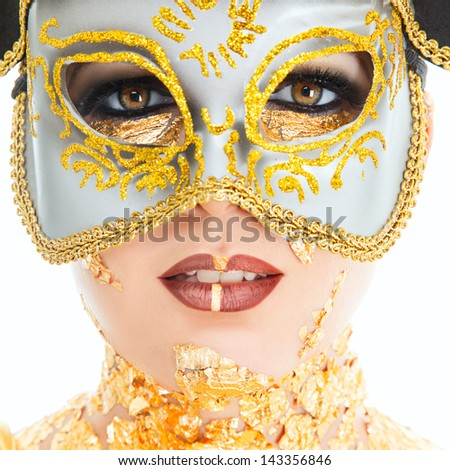 Young woman face with gold make-up and carnival mask isolated on white background - stock photo