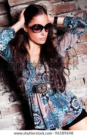 young woman fashion portrait with sunglasses, outdoor shot - stock photo