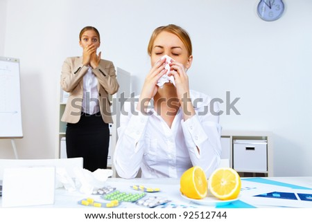 Young woman feeling unwell and sick in office - stock photo