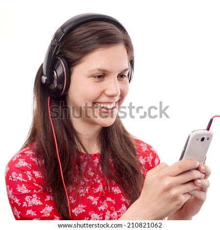 Young woman finding something nice on a smart phone - stock photo
