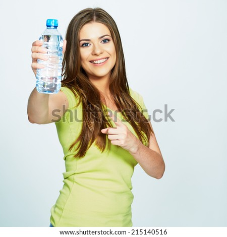 young woman finger  pointing on bottle of water . isolated studio portrait of female model . - stock photo