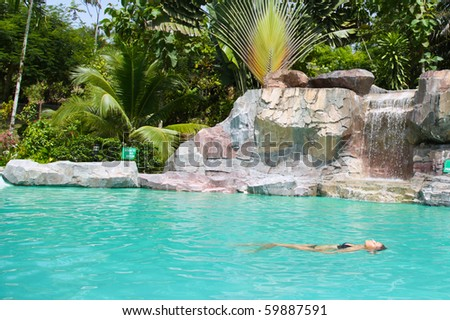 Young Woman Floating In A Pool!