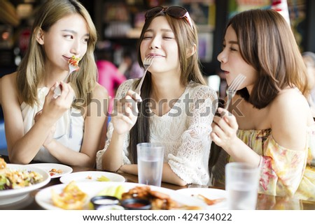 young woman Friends Enjoying Meal in the Restaurant - stock photo