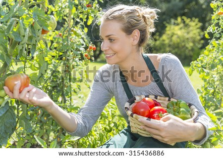 young woman gardening in kitchen garden