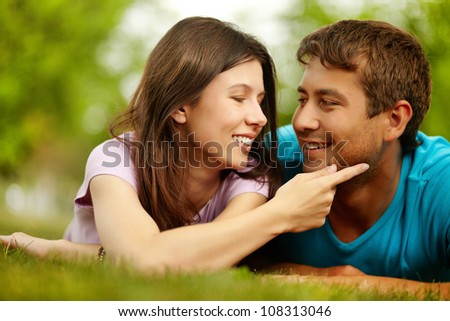 Young woman gently touching the guy�s cheek showing love and affection - stock photo