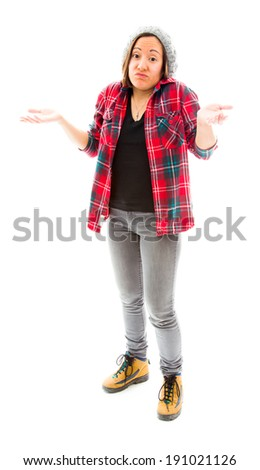 Young woman gesturing and shrugging - stock photo