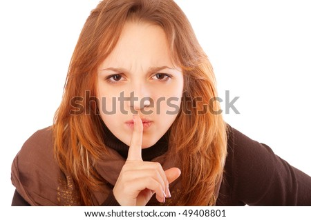 Young woman gesturing silence, isolated on white background. - stock photo