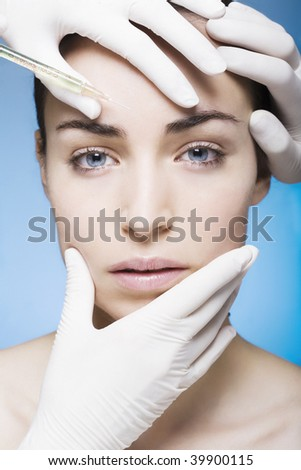 young woman gets an injection - stock photo
