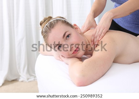 Young woman getting a full body massage at a spa - stock photo