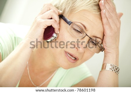 Young woman getting bad news by phone. - stock photo