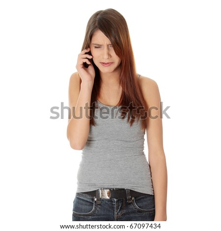 Young woman getting bad news by phone. Isolated on white