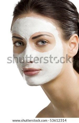 young woman getting beauty skin treatment on her face - stock photo