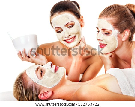 Young woman getting facial mask and gossip . Isolated. - stock photo