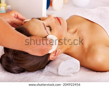 Young woman getting facial  massage in beauty spa. - stock photo