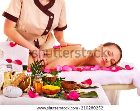 Young woman getting massage in spa . Isolated. - stock photo