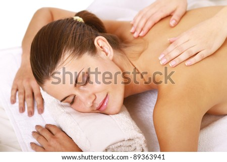 Young woman getting massage on her back