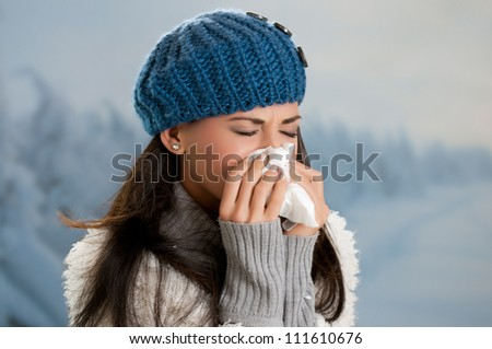 Young woman getting sick with flu in a winter day outdoor - stock photo