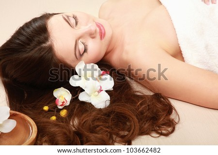 Young woman getting spa treatment isolated on white background