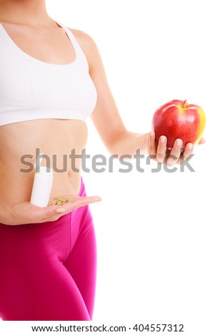 Young woman girl holding pills and apple. Choice between synthetic vitamins natural. Health care. Healthy lifestyle nutrition concept. Isolated on white background. - stock photo