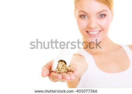 Young woman girl holding vitamins pills. Health care. Healthy lifestyle nutrition concept. Isolated on white background.  - stock photo