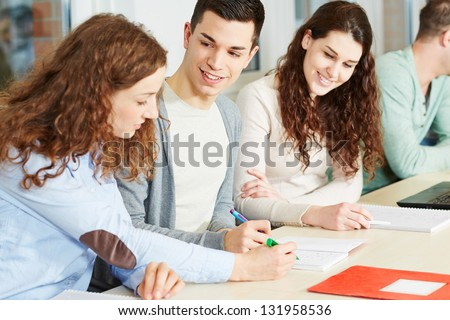 Young woman giving private lessons to school students - stock photo