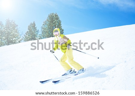 Young woman going downhill fast with clean white snow background - stock photo