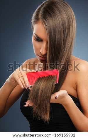 Young woman hair care - stock photo