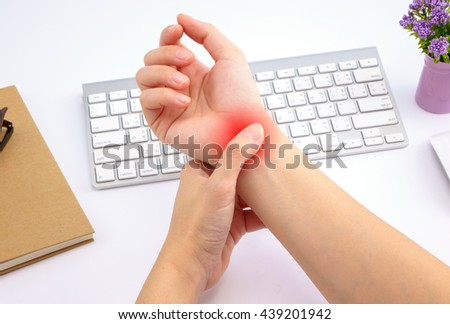 Young woman hand pain with red alert accent