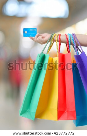 young woman hand with shopping bags and credit card. - stock photo