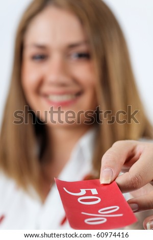 Young woman handing a discount,selective focus on ticket - stock photo