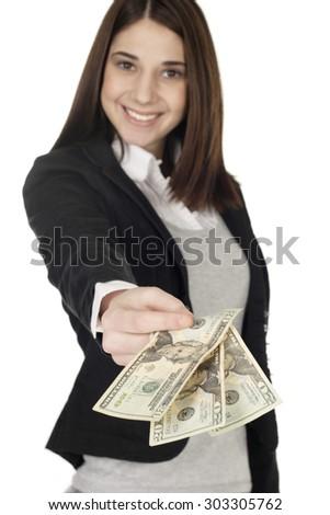 Young woman handing over money. Focus is on money. - stock photo