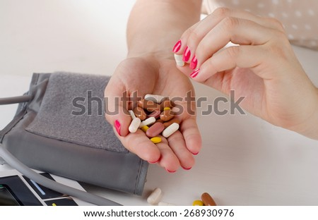 Young Woman hands holding   pills. Selective focus