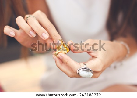Young woman hands unwrap chocolate closeup - stock photo