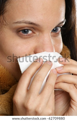 young woman has a cold and one tissue