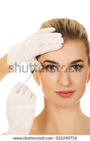Young woman has a cosmetic botox facial injection  - stock photo