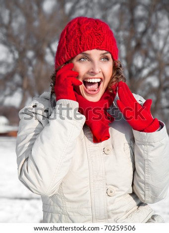 Young woman has a phone call and looking happy - stock photo