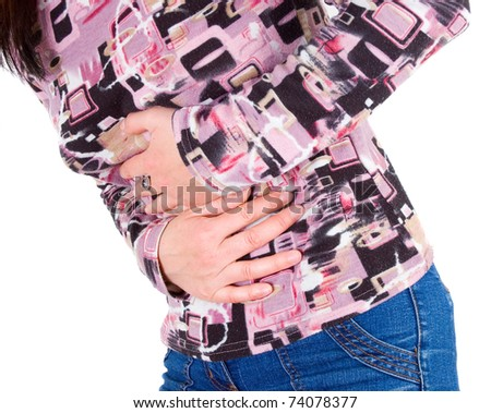 Young woman has abdominal pain - stock photo
