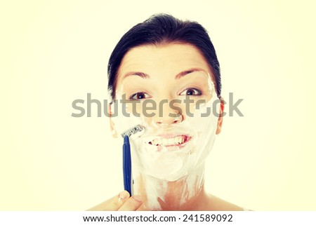 Young woman have morning shave. - stock photo