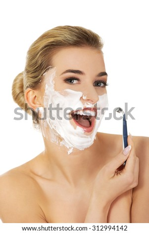 Young woman have morning shave,isolated on white - stock photo