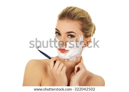 Young woman have morning shave, isolated on white - stock photo