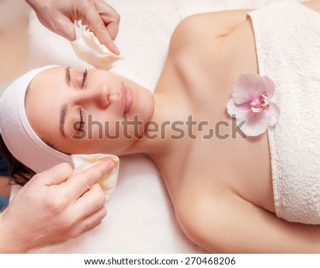 young woman having a honey facial at spa salon - stock photo