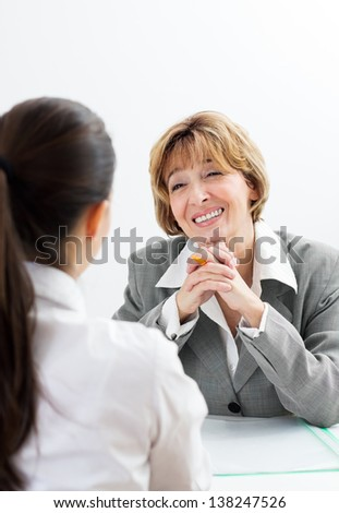Young woman having a job interview. - stock photo