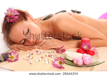 young woman having a lastone massage therapy