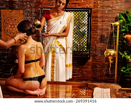 Young woman having ayurveda spa treatment. - stock photo