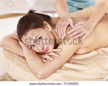 Young woman having classical massage in beauty spa. Series. - stock photo