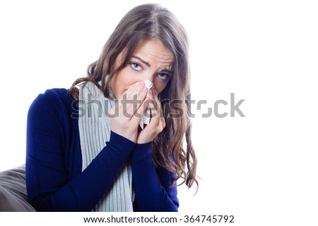 Young woman having flu against white background - stock photo