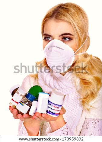 Young woman having flu takes pills. Isolated. - stock photo