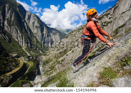 Young woman having fun during mountain ascent - stock photo