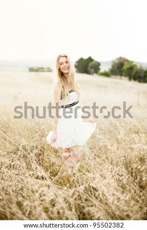 young woman having fun on a sunny day - stock photo