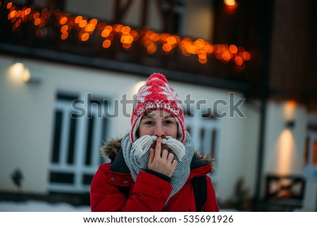 Young woman having fun on winter vacation